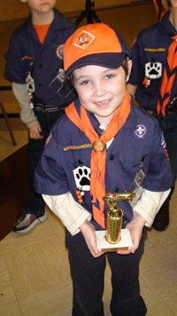 Christopher Court with his Pinewood Derby trophy